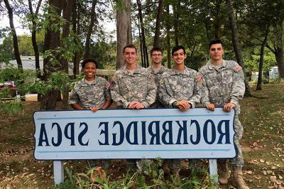 A group of cadets stand behind a sign titled Rockbridge SPCA